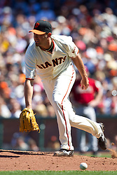 May 30, 2010; San Francisco, CA, USA;  San Francisco Giants relief pitcher Jeremy Affeldt (41) is unable to field a ground ball hit during the eighth inning against the Arizona Diamondbacks at AT&T Park.