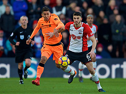 SOUTHAMPTON, ENGLAND - Sunday, February 11, 2018: Liverpool's Roberto Firmino and Southampton's Wesley Hoedt during the FA Premier League match between Southampton FC and Liverpool FC at St. Mary's Stadium. (Pic by David Rawcliffe/Propaganda)