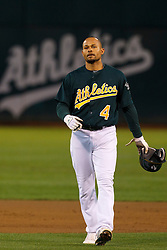 June 28, 2011; Oakland, CA, USA; Oakland Athletics center fielder Coco Crisp (4) returns to the dugout after the first inning against the Florida Marlins at the O.co Coliseum.  Oakland defeated Florida 1-0.