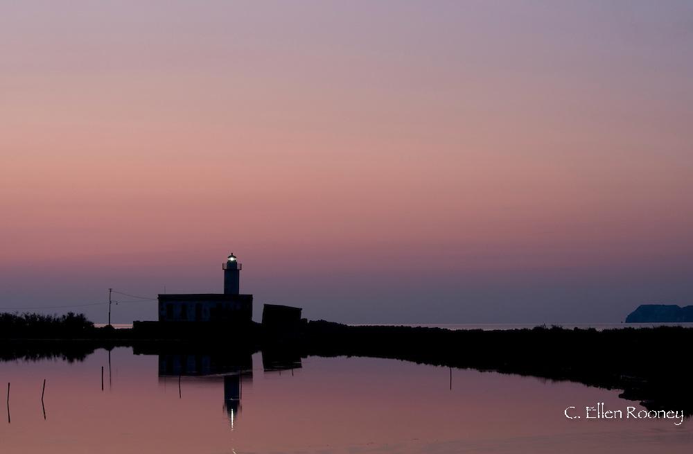 The Punta Lingua Lighthouse at sunrise on the island of Salina in the Aeolian Islands, Sicily, Italy