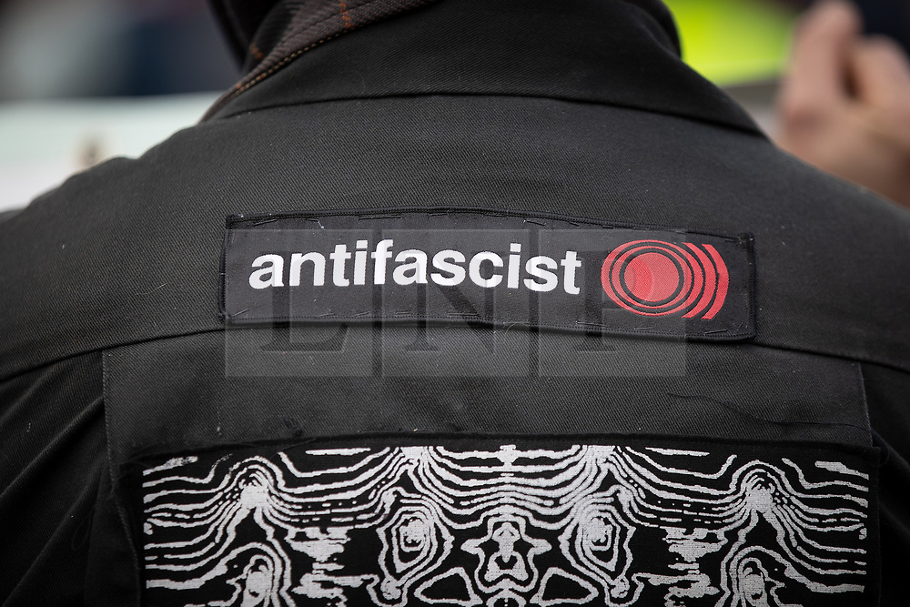 © Licensed to London News Pictures . 22/05/2019. Salford, UK. An ANTI FASCIST PROTESTER at the rally . Former EDL leader Stephen Yaxley-Lennon (aka Tommy Robinson ) holds a campaign rally at the derelict Mocha Parade shopping precinct in Salford , opposed by anti-fascists . Yaxley-Lennon is running for a seat in the European Parliament representing the North West of England . Photo credit: Joel Goodman/LNP