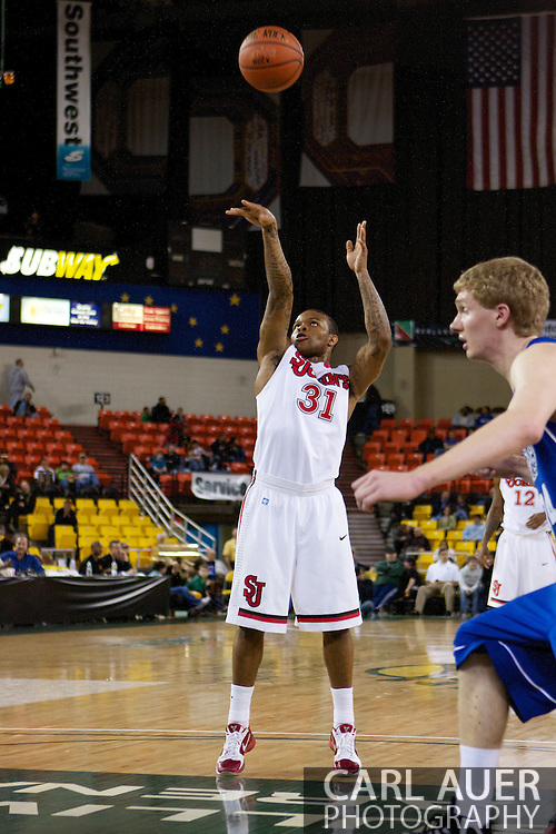 November 26th, 2010:  Anchorage, Alaska - St. John's sophomore guard Malik Stith (31) at the free throw line in the Red Storm's semi final game of the Great Alaska Shootout against the Drake Bulldogs.  The Red Storm defense held Drake to a tournament low score as St. Johns advanced to the final game 82-39.