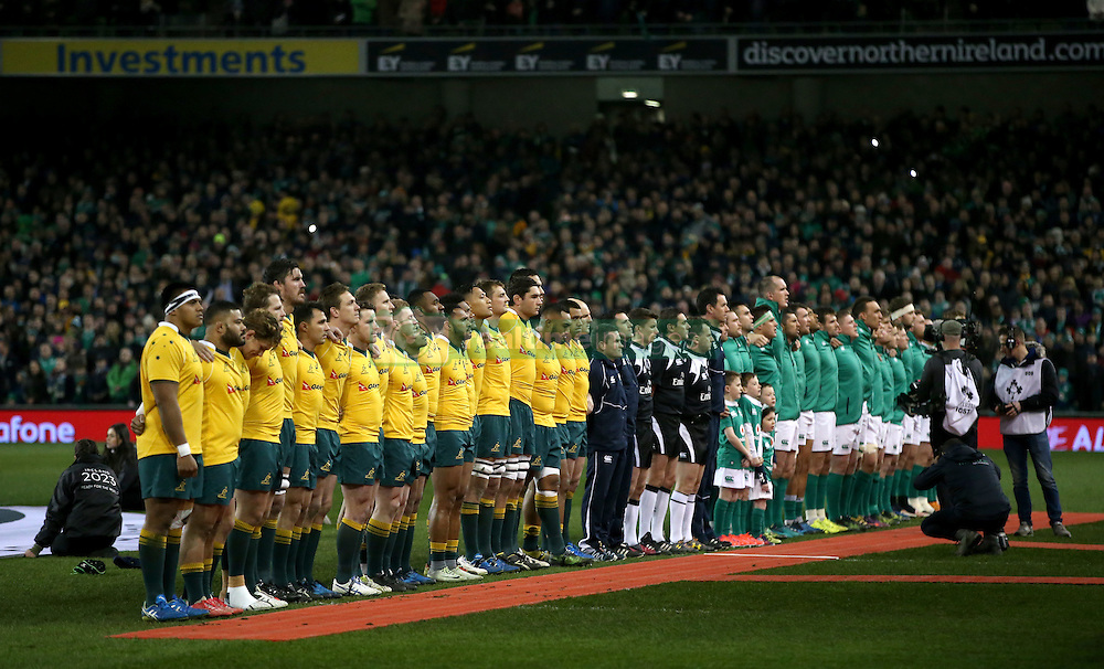 Ireland and Australia players line up for the national anthems before the Aviva Stadium before the Autumn International match at the Aviva Stadium, Dublin.