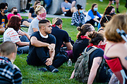 21 JULY 2020 - DES MOINES, IOWA: People listen to speakers eulogize the late Georgia Congressman John Lewis. About 300 people attended a vigil for Congressman Lewis (D-GA) in Poppajohn Sculpture Park in Des Moines Tuesday night. Rep. Lewis died from pancreatic cancer on July 17, 2020.           PHOTO BY JACK KURTZ