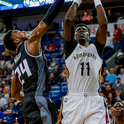 Mar 31, 2017; New Orleans, LA, USA; New Orleans Pelicans guard Jrue Holiday (11) shoots over Sacramento Kings guard Buddy Hield (24) during the first quarter of a game at the Smoothie King Center. Mandatory Credit: Derick E. Hingle-USA TODAY Sports