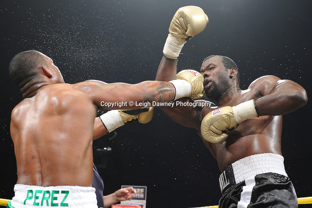 Mike Perez (Irish shorts) defeats Kerston Manswell in Quarter Final 1at Prizefighter International on Saturday 7th May 2011. Prizefighter / Matchroom. Photo credit © Leigh Dawney. Alexandra Palace, London.