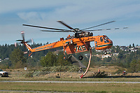 Canadian Air Crane Forest Fire helicopter taking off, Comox, Vancouver Island, Canada   Photo: Peter LLewellyn