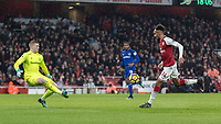 Football - 2017 / 2018 Premier League - Arsenal vs. Everton<br /> <br /> Pierre-Emerick Aubameyang (Arsenal FC) chips the ball over the on rushing Jordan Pickford (Everton FC ) to score on his debut for Arsenal at The Emirates.<br /> <br /> COLORSPORT/DANIEL BEARHAM