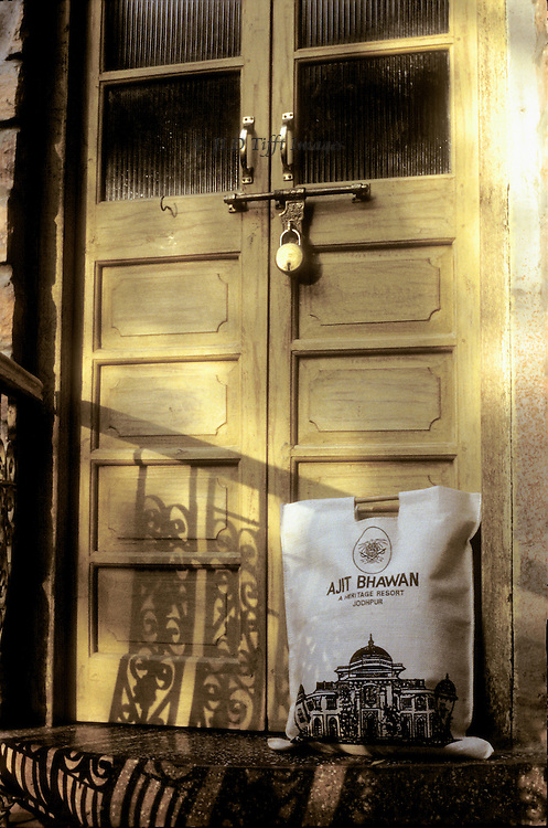 Door with lock and laundry bag at a Rajasthani palace developed into a boutique resort: Ajit Bhawan Heritage Resort.