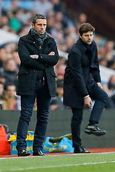 Aston Villa Manager Remi Garde looks dejected as Tottenham Hotspur Manager Mauricio Pochettino looks on - Mandatory byline: Rogan Thomson/JMP - 13/03/2016 - FOOTBALL - Villa Park Stadium - Birmingham, England - Aston Villa v Tottenham Hotspur - Barclays Premier League.