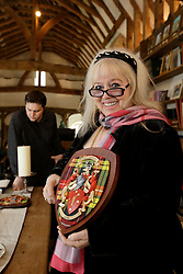 UK ENGLAND THAME 27AUG14 - Dwina Gibb, widow of Bee Gee Robin Gibb presents the Gibb family coat of arms at their home in Thame, Oxfordshire, England.<br /> <br /> <br /> <br /> jre/Photo by Jiri Rezac<br /> <br /> <br /> <br /> © Jiri Rezac 2014