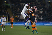 Newcastle United midfielder Mohamed Diame (15)  challenges with Hull City defender Andrew Robertson (3)  for a header during the EFL Quarter Final Cup match between Hull City and Newcastle United at the KCOM Stadium, Kingston upon Hull, England on 29 November 2016. Photo by Simon Davies.