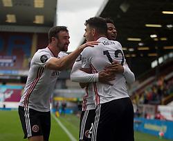 John Egan of Sheffield United (C) celebrates after scoring his sides first goal - Mandatory by-line: Jack Phillips/JMP - 05/07/2020 - FOOTBALL - Turf Moor - Burnley, England - Burnley v Sheffield United - English Premier League