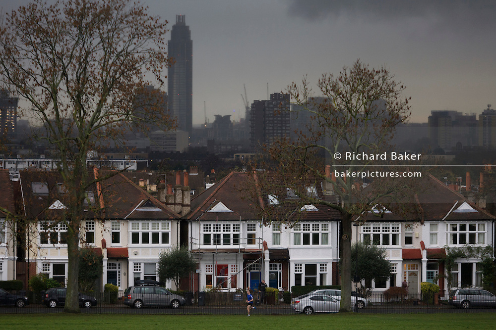 Under dark winter skies, St George tower, the UK's tallest residential building rises above Edwardian homes in Lambeth, south London.<br /> <br /> NOT UPLOADED!