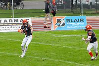KELOWNA, BC - SEPTEMBER 22:  Quarterback Alex Douglas #1 hands the ball off to Kelton Kouri #38 of Okanagan Sun against the Valley Huskers at the Apple Bowl on September 22, 2019 in Kelowna, Canada. (Photo by Marissa Baecker/Shoot the Breeze)
