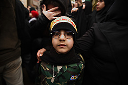 A young boy surrounded by Hezbollah members and supporters pays his respect to slain militant commander Imad Mugniyeh in Beirut, Lebanon on Feb. 14, 2008. Imad Mugniyeh was killed in a mysterious car bombing in Damascus, Syria. Mugniyeh a.k.a. Hajj Radwan, was among the most feared terror operatives in the world.