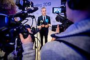 NATO Secretary General Jens Stoltenberg talks to the media at the World Economic Forum in Davos.