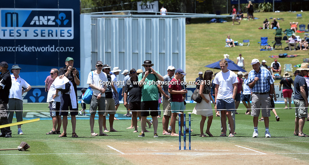 General view at the lunch break as fans inspect the wicket on Day 4 of the 3rd cricket test match of the ANZ Test Series. New Zealand Black Caps v West Indies at Seddon Park in Hamilton. Sunday 22 December 2013. Photo: Andrew Cornaga / www.Photosport.co.nz