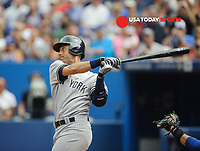 Aug 31, 2014; Toronto, Ontario, CAN; New York Yankees designated hitter Derek Jeter (2) hits a single in first inning against Toronto Blue Jays Rogers Centre. Mandatory Credit: Peter Llewellyn-USA TODAY Sports