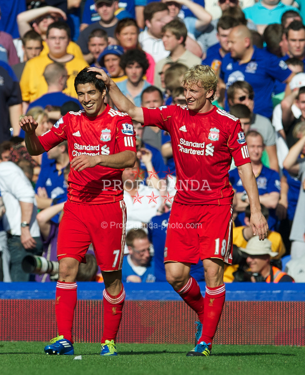 LIVERPOOL, ENGLAND - Saturday, October 1, 2011: Liverpool's Luis Alberto Suarez Diaz celebrates scoring the second goal against Everton with team-mate Dirk Kuyt during the Premiership match at Goodison Park. (Pic by David Rawcliffe/Propaganda)