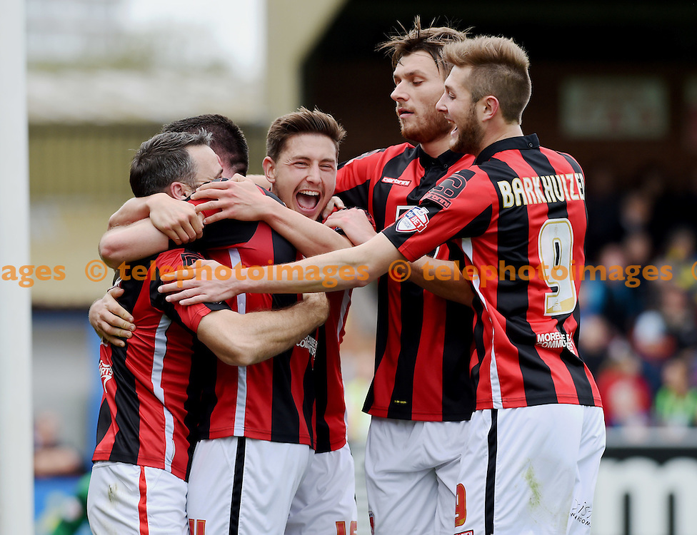 Alan Goodall of Morecambe (left) is mobbed after scoring their third goal in the first half during the Sky Bet League 2 match between AFC Wimbledon and Morecambe at the Cherry Red Records Stadium in Kingston. October 17, 2015.<br /> Simon  Dack / Telephoto Images<br /> +44 7967 642437