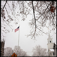 NEWTOWN, CT-10 December 2013- The flag at the rotary in the center of Newtown. Residents of this small New England town want people to stay as they remember the tragedy in which 20 children and seven adults lost their lives one year ago.  The flag was placed at half-staff following the tragedy last year. (Photo by Robert Falcetti)
