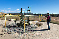 Sharon Wilson, Earthwork's Gulf Regional Organizer using a FLIR camera on Don Schreiber  ranch in Blanco, New Mexico. <br /> The Schreiber's own over 400 acres and lease hundreds more from the BLM. They do not own their mineral rights so they are have to contend with the drilling industry on their land. They successfully took on industry and the BLM, persuading them to twin existing drill sites instead of drilling hundreds of new ones.