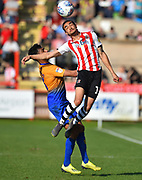 Donovan Wilson (19) of Exeter City gets above Malvind Benning (3) of Mansfield Town to head the ball during the EFL Sky Bet League 2 match between Exeter City and Mansfield Town at St James' Park, Exeter, England on 30 March 2019.