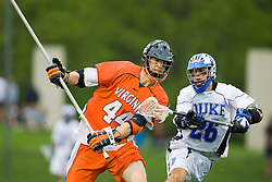Virginia defenseman Mike Timms (44) clears the ball past Duke attackman Zach Howell (26). The #2 ranked Duke Blue Devils defeated the #3 ranked Virginia Cavaliers 11-9 in the finals of the Men's 2008 Atlantic Coast Conference tournament at the University of Virginia's Klockner Stadium in Charlottesville, VA on April 27, 2008.