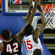 Erie BayHawks Forward Alex Oriakhi (42) tips the ball into the basket as Delaware 87ers Forward Norvel Pelle (15) defends in the first half of a NBA D-league regular season basketball game between the Delaware 87ers (76ers) and the Erie BayHawks (Knicks) Monday, Jan 13, 2014 at The Bob Carpenter Sports Convocation Center, Newark, DE