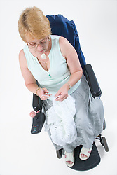 Female wheelchair user knitting,
