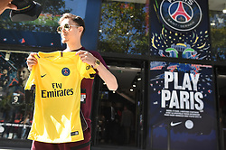 A customer poses with a just purchased jersey outside the Paris Saint-Germain football club's store on the Champs-Elysees avenue on August 3, 2017 in Paris, France. Neymar is set to complete a world-record move to Paris Saint-Germain worth around €402m in fees and wages after telling Barcelona he is leaving. PSG have given the go‑ahead for the forward's buyout fee of €222m to be handed over at the Spanish football federation offices, the protocol required to clear the transfer. Neymar, who flew to Porto on Wednesday for his medical, is expected to be presented in Paris this week. Photo by Eliot Blondet/ABACAPRESS.COM