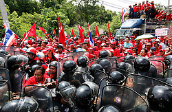 Thai red shirt protestors push through riot police officers to march towards the ASEAN summit venue of the Pattaya Exhibition and Convention Hall (PEACH) demanding the current government step down, on the first day of the Association of South East Asian Nations (ASEAN) plus six summit, in Pattaya, Thailand, about 160 km south east of Bangkok, Thailand, 10 April 2009. Thailand hosts the ASEAN plus three and six summits including leaders of China, Japan, South Korea, India, Australia, and New Zealand, with South East Asian leaders, from April 10 to 12.