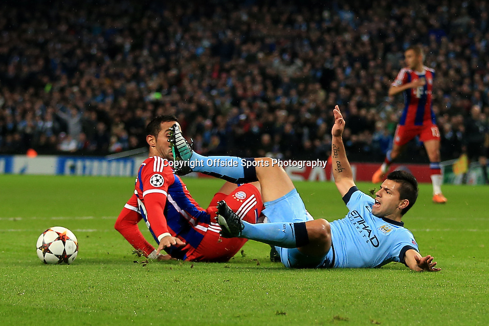 25th November 2014 - UEFA Champions League - Group E - Manchester City v Bayern Munich - Mehdi Benatia of Bayern fouls Sergio Aguero of Man City to concede a penalty and earn himself a sending off - Photo: Simon Stacpoole / Offside.