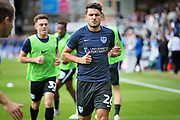 Portsmouth midfielder Gareth Evans (26) warming up before the EFL Sky Bet League 1 match between Peterborough United and Portsmouth at London Road, Peterborough, England on 15 September 2018.