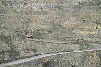 Large mining trucks at Faro mine. Canada's largest open-pit lead-zinc mine.