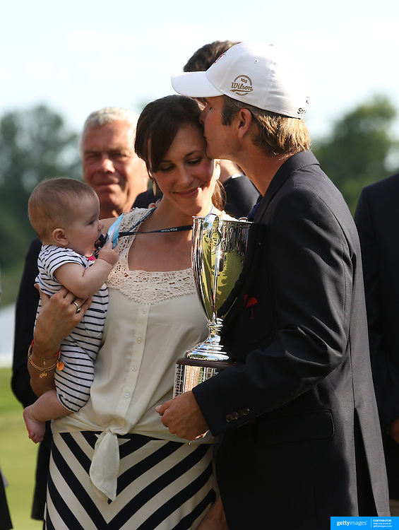 Kevin Streelman kisses his wife, Courtney, who is holding their 6-month-old daughter, Sophia, after winning the Travelers Championship at the TPC River Highlands, Cromwell, Connecticut, USA. 22nd June 2014. Photo Tim Clayton