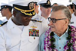 May 21, 2019 - Joint Base Pearl Harbor, Hawaii, U.S. - Cmdr. Allen Maxwell, Jr., prospective commanding officer of Afloat Training Group, Middle Pacific (ATG MIDPAC), speaks with West Loch disaster survivor Joe Kelly during the 75th anniversary of the West Loch Disaster remembrance ceremony hosted by ATG MIDPAC, May 21. On May 21,1944, Army troops were loading ammunition, weapons, and fuel onto vessels. Following an explosion, fire spread through West Loch, the staging area for landing ships at U. S. Naval Base Pearl Harbor, sinking six ships, killing a reported 163 personnel and injuring more than 350. (Credit Image: ? U.S. Navy/ZUMA Wire/ZUMAPRESS.com)