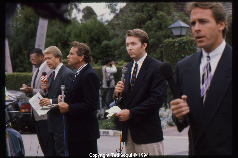 The OJ Simpson trial and media circus.<br /> News reporters lined up in front of OJ Simpson's Brentwood home.