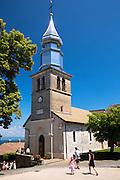 Tourist visit Saint Pancrace d'Yvoire church in the old district of Yvoire by Lac Leman, Lake Geneva, France
