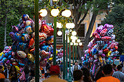 A vendor selling colorful balloons in the central City Square called the Zocalo de Puebla in Puebla, Mexico.