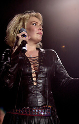 Kim Wilde steps out of the her TV Gardening clothes and Back on Stage to Tour with<br /><br />Steve Starnge (Visage)<br />Claire Grogan (Altered Images)<br />The Belle Stars<br />Dollar<br />Kim Wilde<br />The Human League<br />Play on the Here and Now  Christmas Party Tour at Sheffields Hallam FM Arena Friday 13th December 2002<br /><br />[#Beginning of Shooting Data Section]<br />Nikon D1 <br />2002/12/13 22:43:49.6<br />JPEG (8-bit) Fine<br />Image Size:  2000 x 1312<br />Color<br />Lens: 80-200mm f/2.8-2.8<br />Focal Length: 80mm<br />Exposure Mode: Manual<br />Metering Mode: Spot<br />1/200 sec - f/2.8<br />Exposure Comp.: 0 EV<br />Sensitivity: ISO 800<br />White Balance: Auto<br />AF Mode: AF-S<br />Tone Comp: Normal<br />Flash Sync Mode: Not Attached<br />Color Mode: <br />Hue Adjustment: <br />Sharpening: Normal<br />Noise Reduction: <br />Image Comment: <br />[#End of Shooting Data Section]