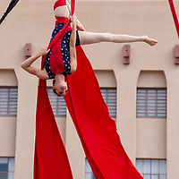 Elise Southwick, 30, with Wise Fools Circus performers aerial fabric acrobatics in the McKinley County Courthouse Square Saturday evening during the Route 66 Freedom Ride, Flight and Cruise event.