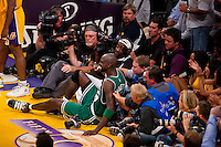 17 June 2010: Forward Kevin Garnett of the Boston Celtics falls into the photographers while playing against the Los Angeles Lakers during the second half of the Lakers 83-79 championship victory over the Celtics in Game 7 of the NBA Finals at the STAPLES Center in Los Angeles, CA.