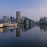 Baltimore Maryland USA Inner Harbor and yacht marina at sunrise with city skyline in background