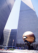 Bronze sculpture by Fritz Koenig, The Sphere, a symbol of peace, in the middle of Austin J. Tobin plaza, between the World Trade Center Twin Towers, New York, NY.  The artwork was meant to symbolize world peace through world trade, and was placed at the center of a ring of fountains and other decorative touches designed by trade center architect Minoruy Yamasaki to mimic the Grand Mosque of Mecca, Masjid al-Haram, in which The Sphere stood at the place of the Kaaba.