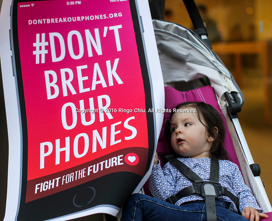 Arya Tappy, 15 months, sits in her stroller while her Grandmother Darlene Ceglarek protests in a rally in support of data privacy outside the Apple store, Tuesday, Feb. 23, 2016, in Los Angeles. Protesters assembled in more than 30 cities around the world to lash out at the FBI for obtaining a court order that requires Apple to make it easier to unlock an encrypted iPhone used by a gunman in December's mass murders in California.(Photo by Ringo Chiu/PHOTOFORMULA.com)<br /> <br /> Usage Notes: This content is intended for editorial use only. For other uses, additional clearances may be required.