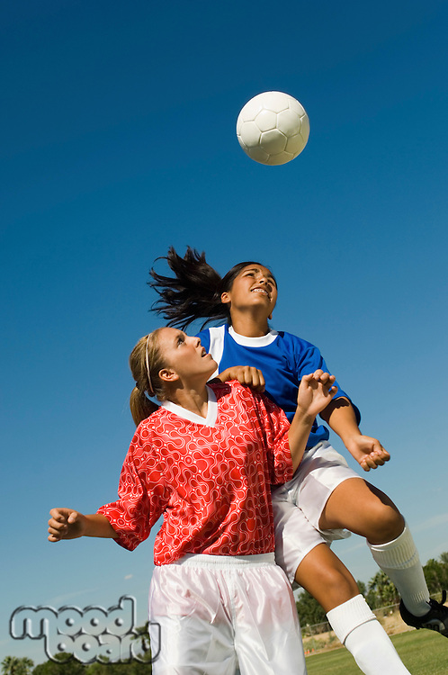 Girls (13-17) attempting to head soccer ball