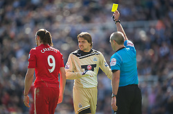 NEWCASTLE-UPON-TYNE, ENGLAND - Sunday, April 1, 2012: Liverpool's Andy Carroll is shown a yellow card by referee Martin Atkinson for diving during as Newcastle United's goalkeeper Tim Krul shouts abuse the Premiership match at St James' Park. (Pic by David Rawcliffe/Propaganda)