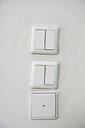 three Light switches on a wall